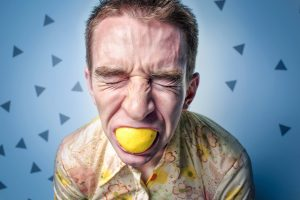 Man sucking lemon